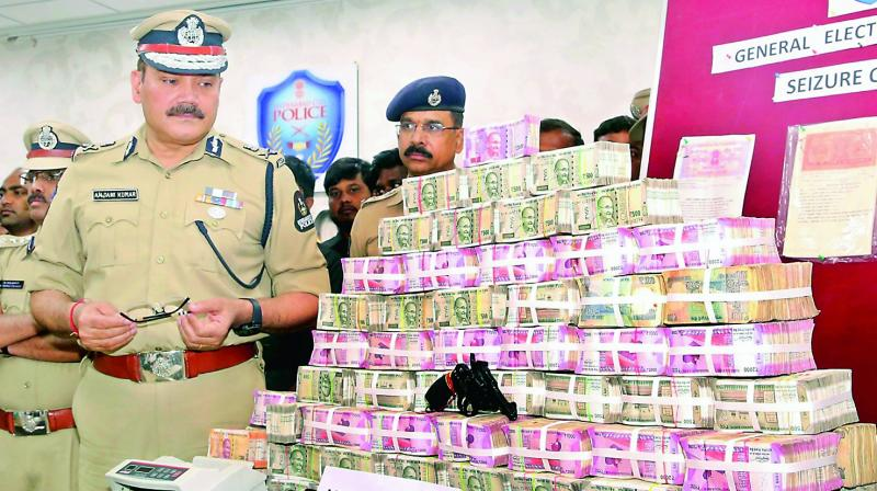 Police commissioner Anjani Kumar shows money seized in checks on Wednesday.  (GANDHI)