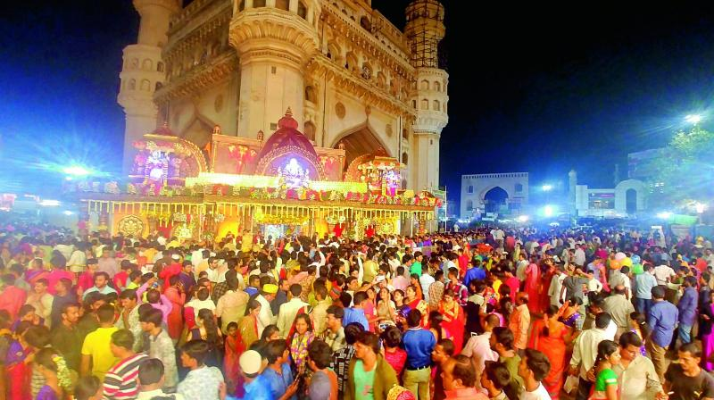 Thousands of devotees offer prayers at the Bhagyalakshmi temple near Charminar in Hyderabad on Wednesday midnight.  (DC)