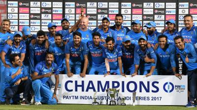 Team India members celebrate their 4-1 victory over Australia during the presentation ceremony after the fifth ODI. (Photo: PTI)