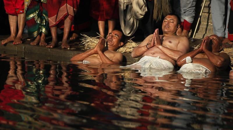 During the festival devotees recite holy scriptures dedicated to the Hindu goddess Swasthani and Lord Shiva. (Photo: AP)