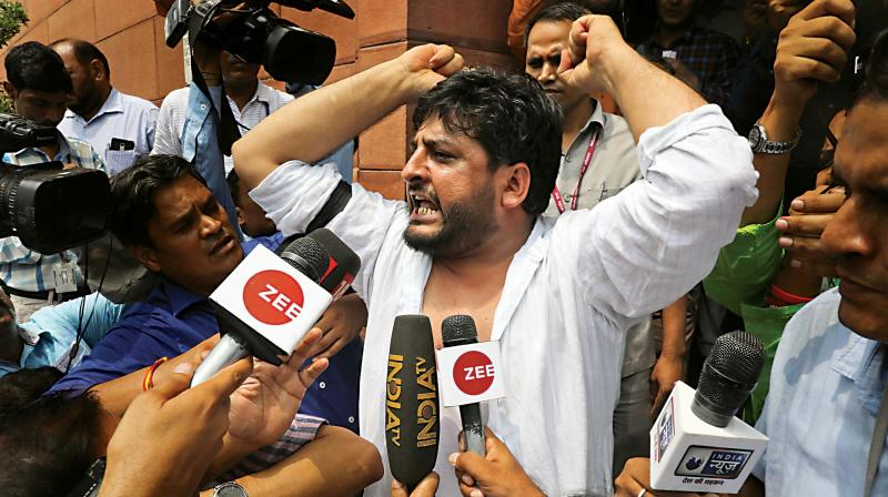 PDP lawmaker Fayaz Ahmed Mir shouts slogans against government's move to abrogate Article 370, outside Parliament House in New Delhi on Monday. (Photo: PTI)