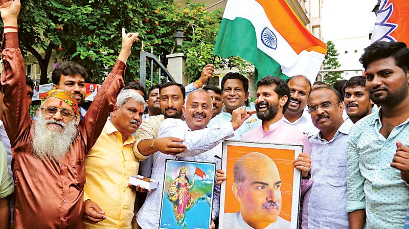 BJP leader C.T. Ravi and others celebrate the repealing of Article 370  near BJP office at Malleswaram, in Bengaluru on Monday.
