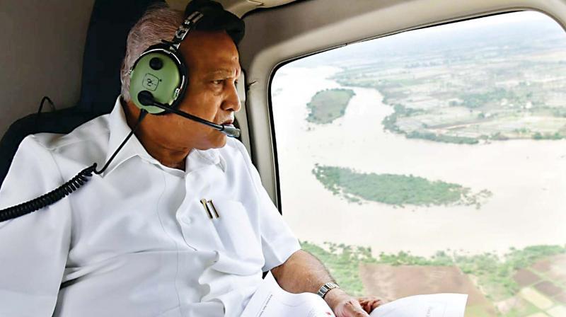 Chief Minister B.S. Yediyurappa conducting an aerial survey of flood-hit areas in North Karnataka on Monday.