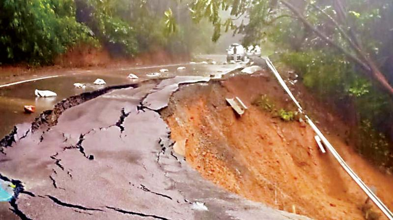 Landslides occurred on Virajpet-Makutta Road as rain lashed Kodagu on Monday.