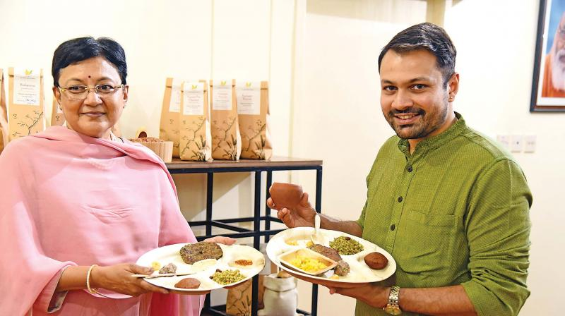 Sheila Balaji, Chairperson, AIm for Seva and Rakesh Raghunathan, food expert, present rice varieties. (Photo: DC)