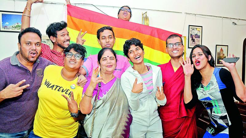 LGBT rights activists celebrate the Supreme Court ruling that legalised same sex relationships at Lamakaan in Hyderabad on Thursday. (Image: Deepak Deshpande)