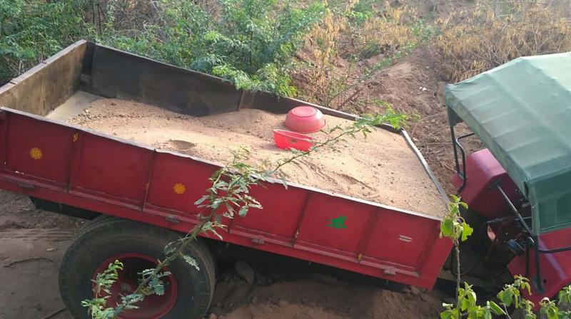 The trailer with sand seized near Periyanaickenpalaym forest range 	 Image: DC