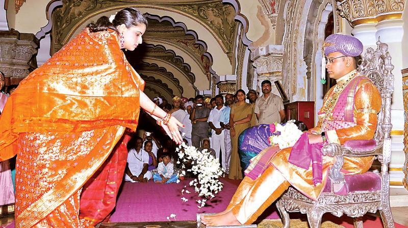 Mysuru scion Yaduveer Krishnadatta Chamaraja Wadiyar and his wife Trishika Kumari Devi perform rituals before the start of private Dasara celebrations at the Mysuru Palace (Photo: KPN)
