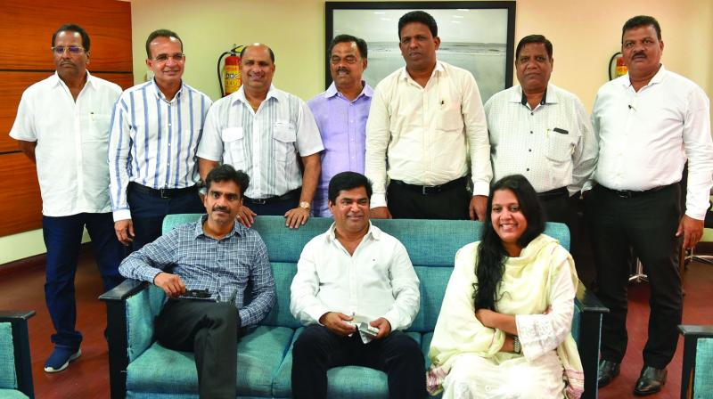 Chandrakant Babu Kavlekar (sitting at centre), the Leader of Opposition in the Goa Assembly, and other Goa Congress rebel MLAs at Goa Niwas in New Delhi on Thursday. (Photo: AP)