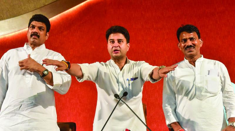 Congress leader Jyotiraditya Scindia addresses a press conference in Bhopal on Thursday.