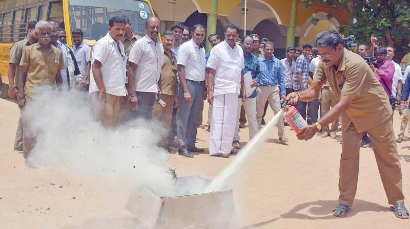 Transport minister M.R. Vijayabhaskar inspects school buses in Chennai on Monday. (Photo: DC)