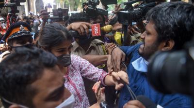 Bollywood actress Rhea Chakraborty (C) struggles with media representatives gathering as she arrives at the Narcotics Control Bureau (NCB) office for enquiry regarding Sushant Singh Rajput case, in Mumbai. PTI Photo