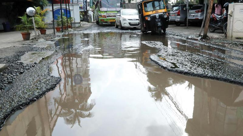 The huge crater formed at St Benedict road near North railway station in Kochi following heavy rains. (file pic)