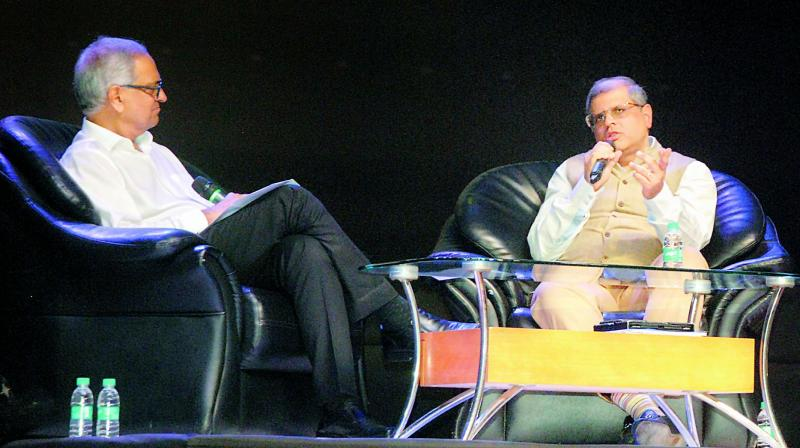Managing Director of Bain Capital Amit Chandra (right) interacts with Trustee Manthan Foundation Ajay Gandhi at Manthan Samvaad in Shilpakala Vedika on Tuesday.