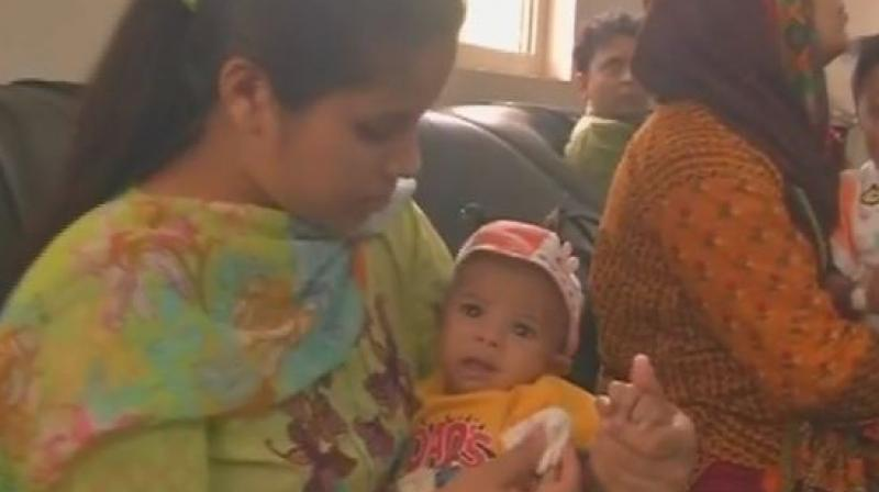 Appreciate EAM Sushma Swaraj, she helped me a lot, father of the infant Rohaan, who arrived in India for treatment said. (Photo: ANI/Twitter)