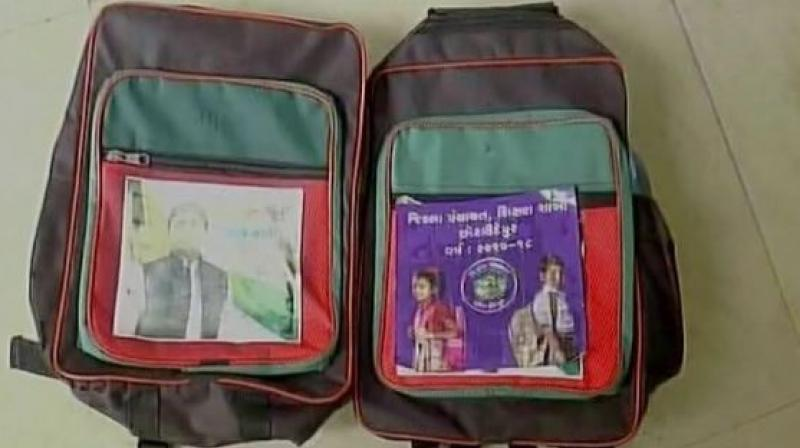 The bags were apparently manufactured for distribution in Uttar Pradesh when the Samajwadi Party was in power. (Photo: ANI/Twitter)