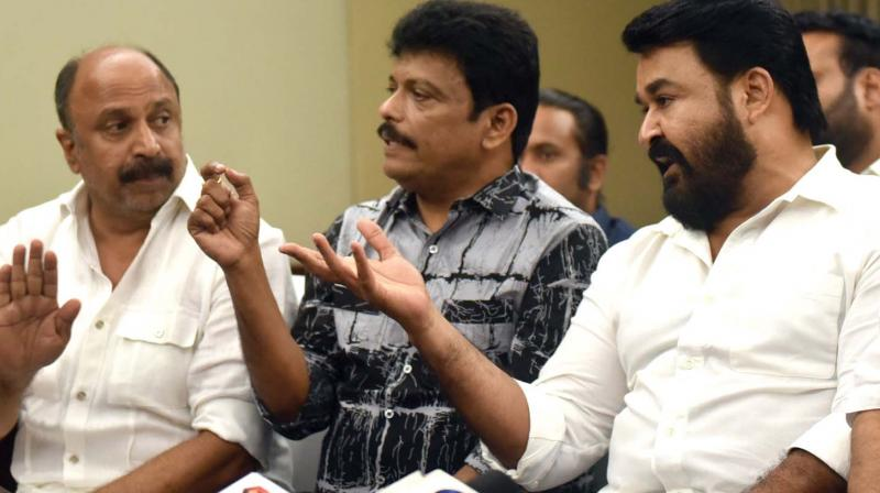 AMMA president Mohanlal along with Jagadish and Siddique at the press meet after the executive committee meeting in Kochi on Friday. Image; Arun Chandrabose