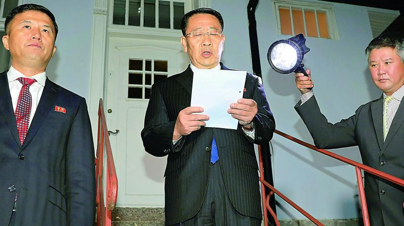 North Korean negotiator Kim Miyong Gil reads statement outside the North Korean Embassy in Stockholm, Sweden on Saturday.(Photo: AP)