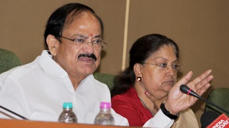 Union Urban Development Minister M Venkaiah Naidu and Rajasthan CM Vasundhara Raje addressing a press conference. (Photo: AP)
