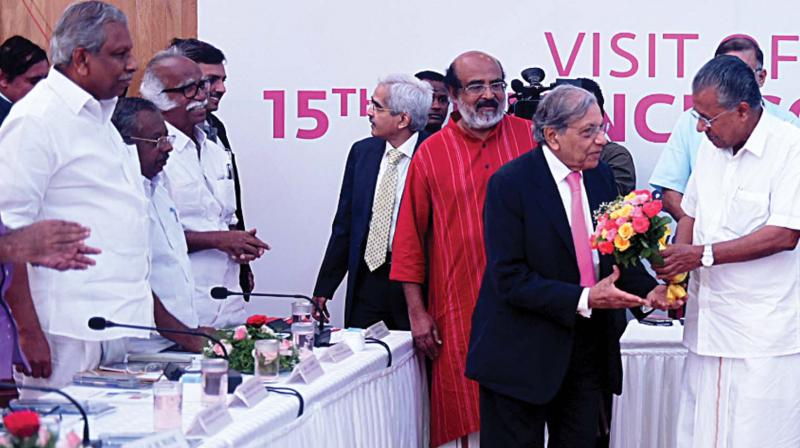 Chief Minister Pinarayi Vijayan welcomes Fifteenth Finance commission chairman N.K. Singh at a sitting with Kerala ministers in Thiruvananthapuram on Monday. Ministers A.C. Moideen, P.K. Raju, Kadannappali Ramachandran and T.M. Thomas Isaac are seen nearby. (Photo: DC)