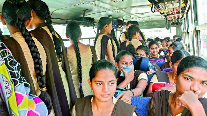 Students forced to travel standing in an overcrowded school bus in Vijayawada on Thursday.  (Deccan chronicle)