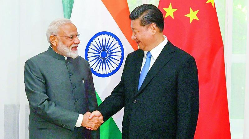 Prime Minister Narendra Modi meets Chinese president Xi Jinping in Bishkek on Thursday.  (PTI)
