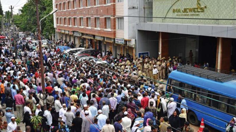 Investors outside IMA Jewels outlet in Shivajinagar