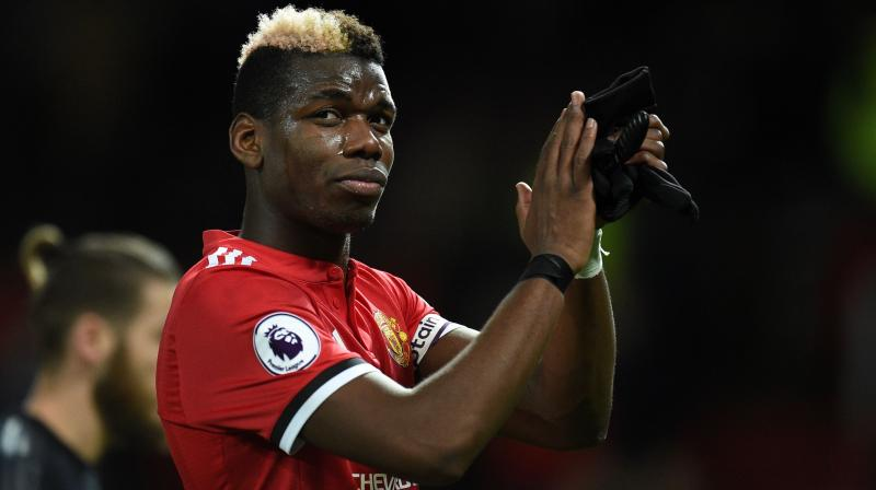 The club has had to deny the claim that Pogba sent a text message to Woodward demanding he be allowed to leave. (Photo: AFP)