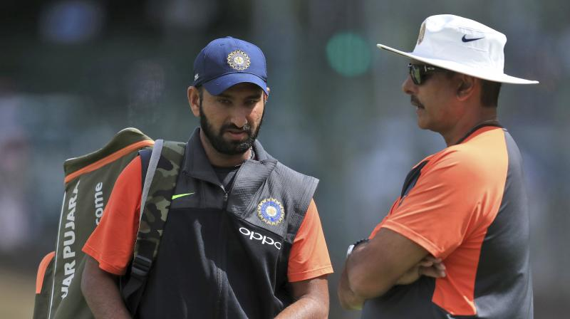 Pujara may not have set alight county cricket with his Yorkshire stint but many believe the time he spent in the country gives him a distinct advantage over his team mates. (Photo: AP)
