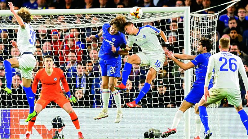 David Luiz (No.30) of Chelsea and Dynamo Kiev's Vitaliy Mykolenko head the ball during their Europa League Round of 16 first leg match at Stamford Bridge stadium in London on Thursday. Chelsea won 3-0. (Photo: AP)