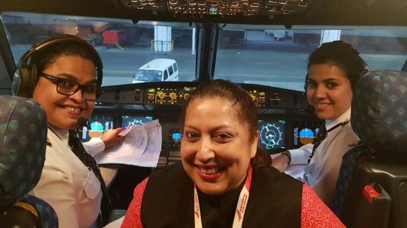 Captain M.Deepa Commander First officer and Vrinda Nair operate all women crew Air India flight Chennai to New Delhi along with women staff as part of Women's Day celebrations. (Image DC)