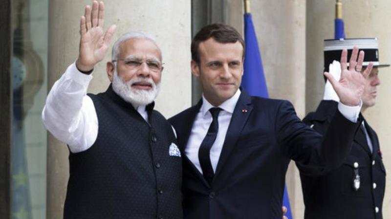Prime Minister Narendra Modi and French President Emmanuel Macron have been jointly awarded with the UN's highest environmental honour for their pioneering work in championing the International Solar Alliance and promoting new areas of cooperation on environmental action. (Photo: AP)