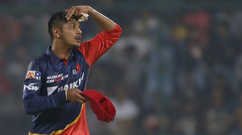Sandeep Lamichhane, aged 17 and the first Nepalese player to land an IPL contract, took one wicket for 25 from his four overs opening the attack with his leg-spin for Delhi Daredevils against Royal Challengers Bangalore. (Photo: AP)