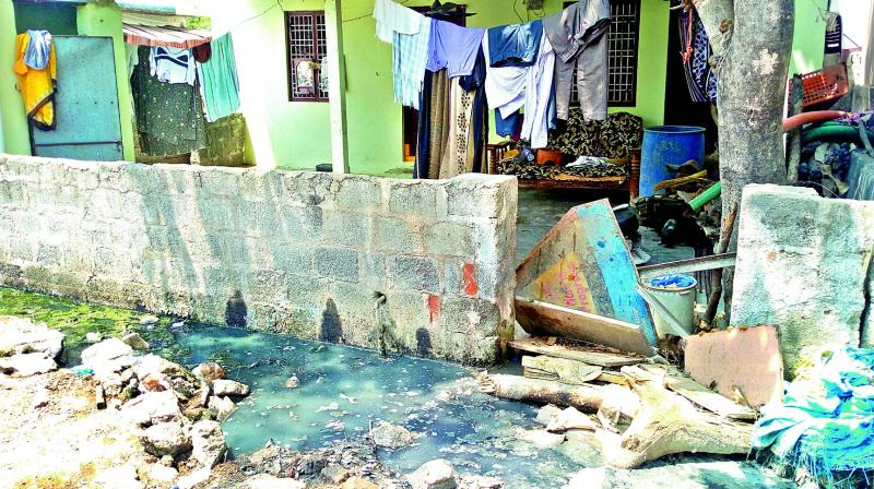 With no proper drainage in place water from a household toilet stagnates on the roadside in Deendayalnagar Colony on Thursday. 	(Photo:  DC)