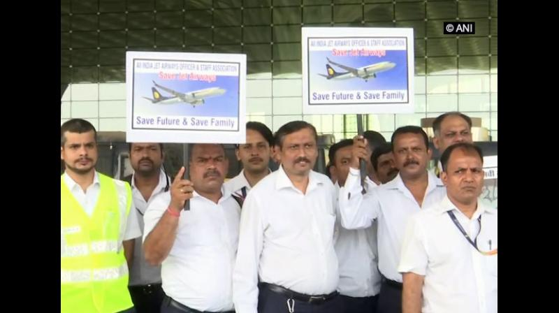 'On Labour Day, we have gathered for a peaceful protest. We did not get our salaries for two months. Our mediclaim policy had also lapsed,' Krishna Rama Naidu, an employee in the cargo department of Jet Airways said. (Photo: ANI)