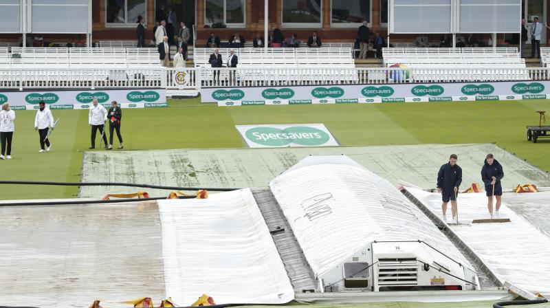 When the match should have been getting underway, the square and pitch remained fully covered and prospects of any play before lunch appeared slim. (Photo: AP)