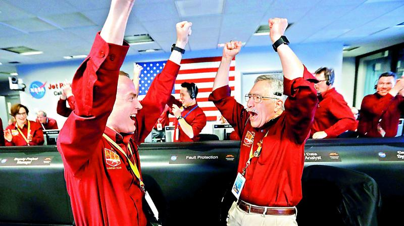 Nasa engineers react after the successful landing by the InSight spacecraft on the planet in California on Tuesday. (Photo: AP)