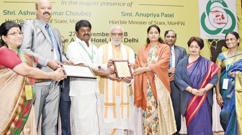 Tamil Nadu awarded for the highest number of transplantations in any state across the country for the fourth consecutive year on Tuesday. Health minister C. Vijayabaskar receives the award from Anupriya Patel, Union minister of state. (Photo: DC)