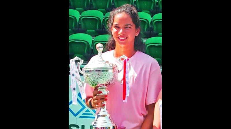 Sowjanya Bavisetti of Telangana poses with the women's singles trophy.