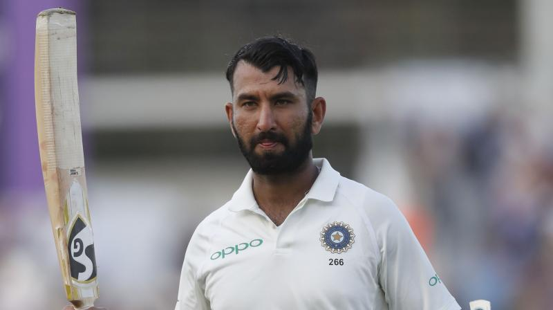 Cheteshwar Pujara scored a gritty 123 in punishing conditions to claw India back into the opening Test in Adelaide Thursday after Australia seized early control with some blistering bowling. (Photo: AP)