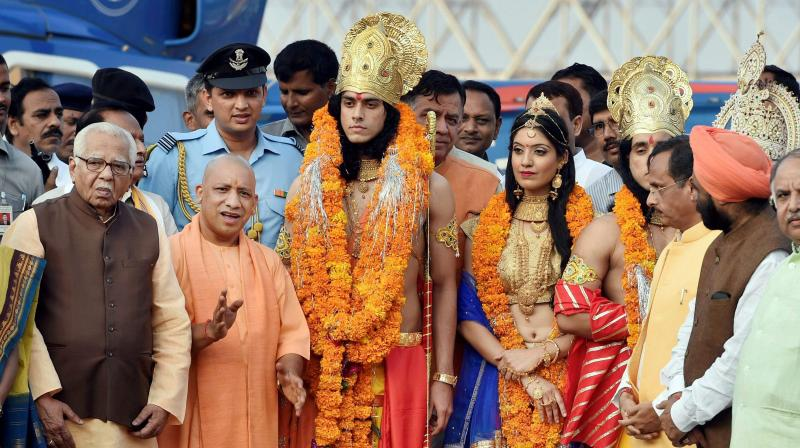 Uttar Pradesh Governor Ram Naik and Chief Minister Yogi Adityanath with artistes dressed up as Lord Rama Sita and Lakshman during Deepotsav celebrations in Ayodhya. (Photo: PTI)