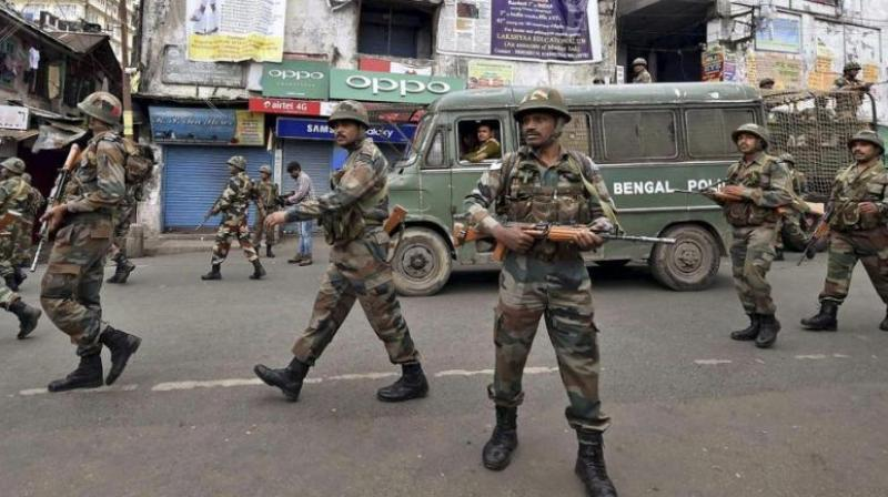 Security personnel patrol a road during a GJM strike in Darjeeling on Saturday. (Photo: PTI)