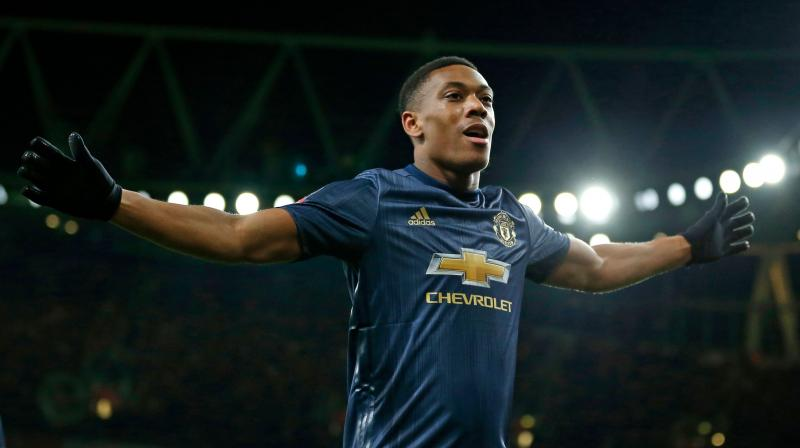 United announced that the France striker had signed a new contract that commits him to the club until at least June 2024, with the option for a further year. (Photo: AFP)