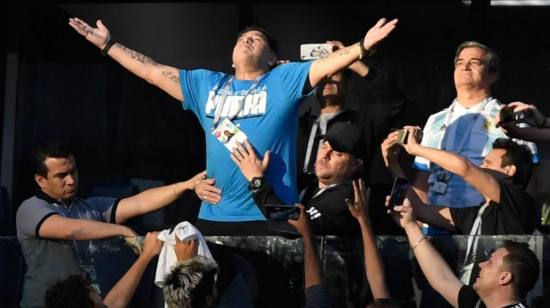 Throughout Argentina's nerve-shredding 2-1 victory, which secured the South American giants' passage into the last 16, the host broadcaster television feed regularly cut to images of Maradona as the tension mounted. (Photo: AFP)