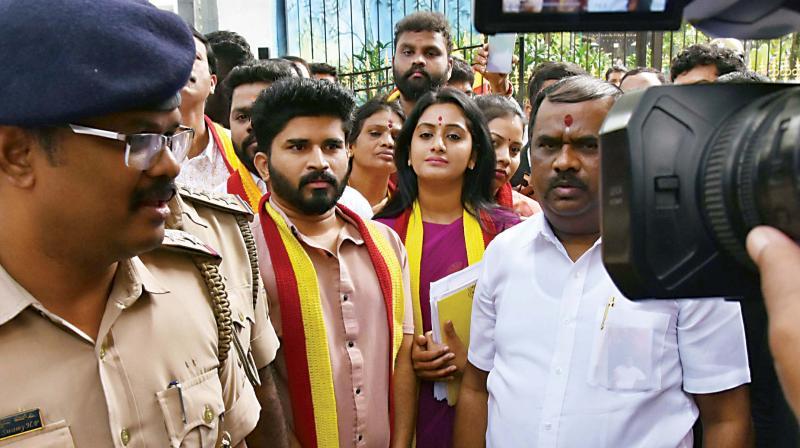 Ashwini Gowda and other members of Karnataka Rakshana Vedike surrender at DCP office in Bengaluru on Friday. (KPN)