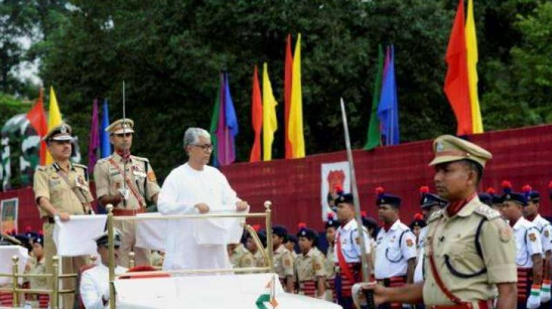 Tripura Chief Minister Manik Sarkar inspects 71st Independence Day parade in Agartala on Tuesday. (Photo: PTI)