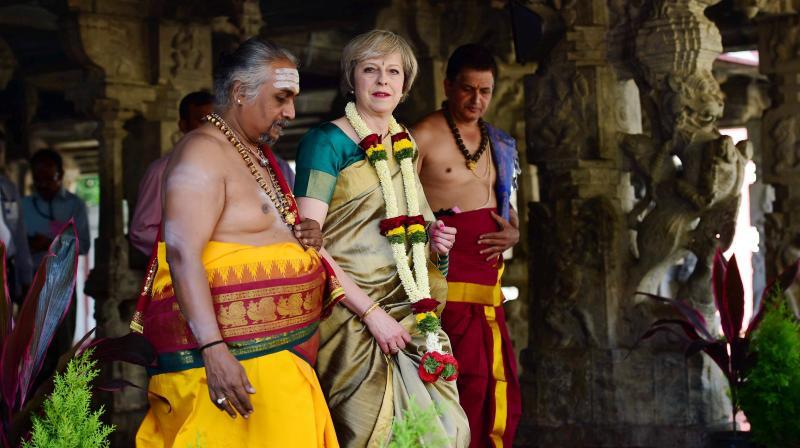 British Prime Minister Theresa May, donning a saari, visits the Someshwara temple in Bengaluru on Tuesday. (Photo: PTI)