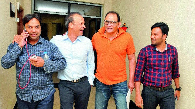 Presidential contestant Mohammad Azharuddin (second from right) shares a light moment with former HCA joint secretary Purshotham Agarwal (second from left) as treasurer candidate Surender Kumar Agarwal (left) and HCA staffer Mohammad Yousuf look on at the Rajiv Gandhi International Cricket Stadium in Uppal, Hyderabad.(Photo: DC)