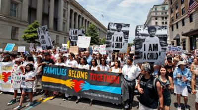Activists march to protest the Trump administration's approach to illegal border crossings and separation of children from immigrant parents, Saturday, June 30, 2018, in Washington. (Photo: AP)