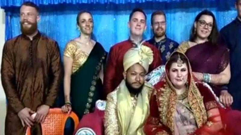 Emma Lorre, the girl from Sweden, and Mohammad Azharuddin of Kandhamal take a picture with family members after their wedding ceremony on Sunday. — DC
